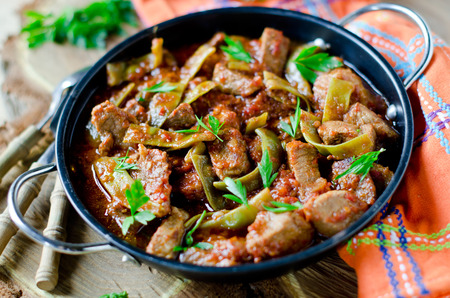 Meat stew with green beans Stock Photo