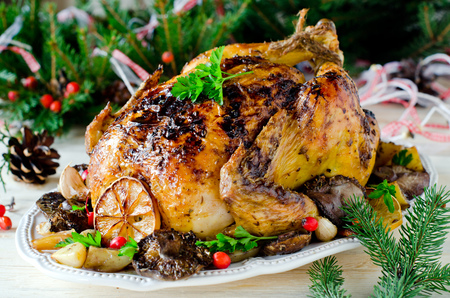 Christmas chicken (turkey) baked with mushrooms and potatoes Stock Photo