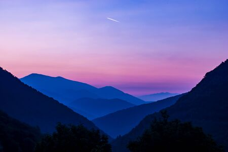 sunrise in the italian mountains above the lago maggiore with  beautiful pink colours and mountain silhouettes