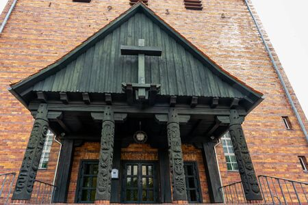 Protestant Johannes church in Berlin Frohnau Germany with carving details of the entrance