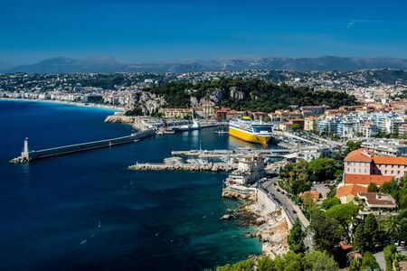 view over Nice harbour, lighthouse and mole and baie des anges with gorgeous blue skies Foto de archivo