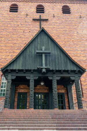 Protestant Johannes church in Berlin Frohnau Germany with carving details of the entrance 版權商用圖片
