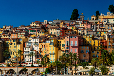 Colourful houses in the old town of Menton in France view from the sea