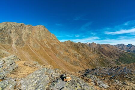 Panoramic view of the Texel group mountains in the austrian/italian alps at the Timmelsjoch summit on a clear and sunny day in autumn 2019