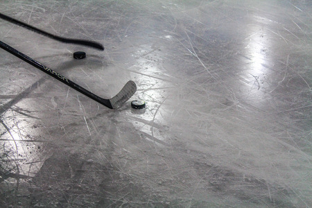 puck: Hockey stick and puck on the ice