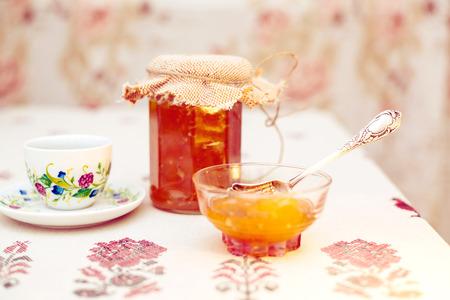 Tea with peach jam retro