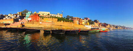 yellow ochre: Ancient city in India, view from Ganga river, historical cityscape, indian city panorama in the morning