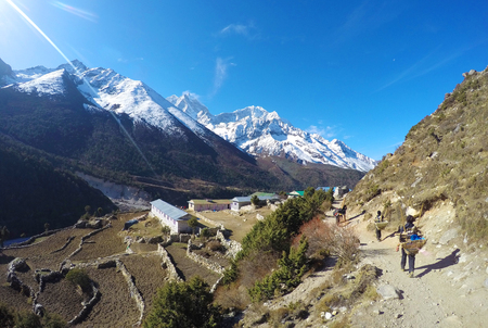 sherpa: Nepalese porter sherpa, small mountain village, trek to Everest, Nepal Stock Photo