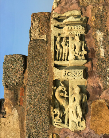 kamasutra: The carved relief on an old temple, India