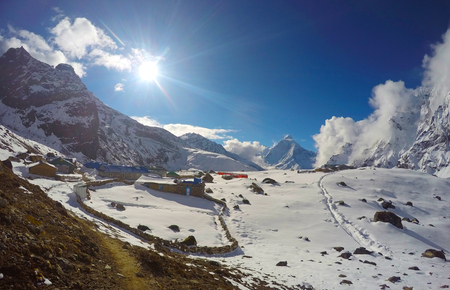 unaffected: Sun above Himalayan peaks, trek to Everest base camp, Nepal