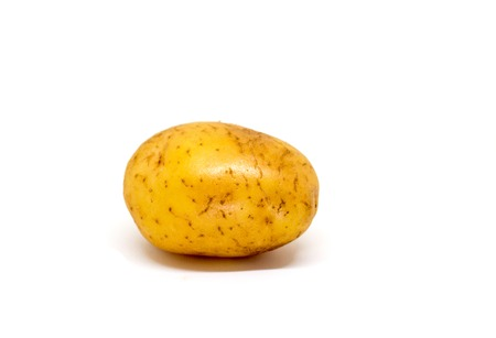 Ripe potato on white background. Brown and yellow vegetable isolate image. Single oval potato photo. Picture of raw potato for cooking. Vegetarian food. French fries or mashed potato ingredient Stock Photo