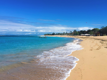idyllic: White beach in the daytime with perfect blue sea and clear blue sky. Idyllic seaside landscape for holiday relax, honeymoon, wanderlust travel. Soft sand and clear water. Tropical island paradise