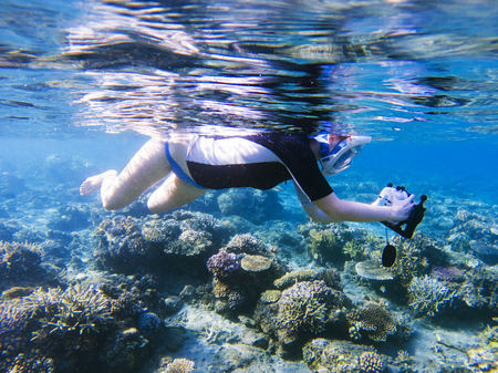 Snorkeling Girl With Underwater Camera In Coral Reef Snorkel Housing