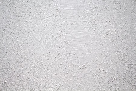 Painted wall with rough texture closeup photo. White plaster with brushed texture. White house wall. Greek architecture background. Pottery house wall. White painted surface. Vintage or shabby chic Stock fotó