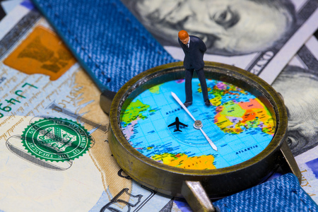 Businessman figurine on time money background. Worldwide business concept. Businessman macro photo. Global corporation strategic planning decision. Emerging markets profitability. Business expansion