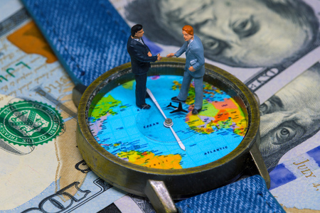 Watch with global map on cash money world map clock worldwide two businessman figurines on time and money background worldwide business concept international business agreement gumiabroncs Images