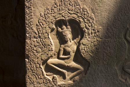 Dancing apsara bas-relief in Angkor Wat, Siem Reap, Cambodia.