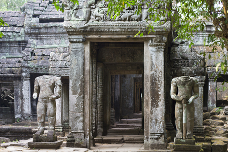 Ancient ruins of Preah Khan temple with stone carving, Siem Reap, Cambodia. Фото со стока