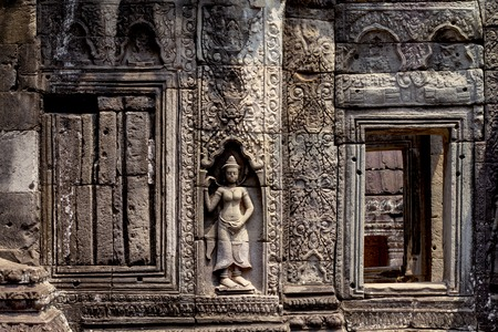 Carved wall bas-relief of Angkor Wat complex temple, Siem Reap, Cambodia. Ancient khmer architecture. Angkor Wat temple archaeological site. Asian tourism sightseeing. Floral ornament stone carving