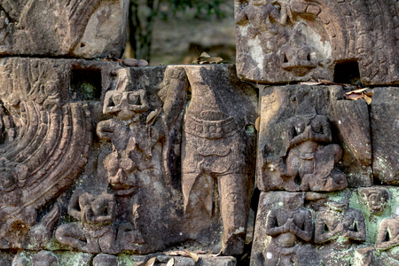 Carved figures bas-relief of Angkor Wat complex temple, Siem Reap, Cambodia. Ancient khmer architecture. Angkor Wat temple archaeological site. Asian tourism sightseeing. Stone ruin puzzle with buddha 스톡 콘텐츠