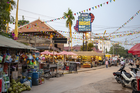 Siem Reap, Cambodia - 25 March 2018: Night Market of souvenir and craft day view. Tourist attraction in cambodian city. Tourism industry business. Local souvenir for sell. Decorated square with shops