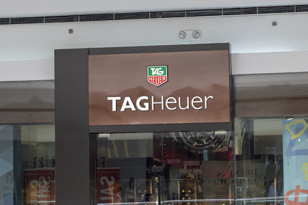 Philippines, 22 March 2018 - Tag Heuer brand name on store entrance in shopping mall. Expensive watch store label. Swiss watches shop. Fashion accessories storefront. Watch shop label closeup photo Editorial