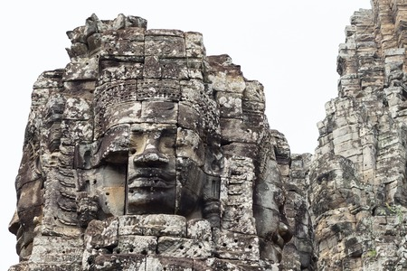 Stone face tower of ancient buddhist temple Bayon in Angkor Wat complex, Cambodia.