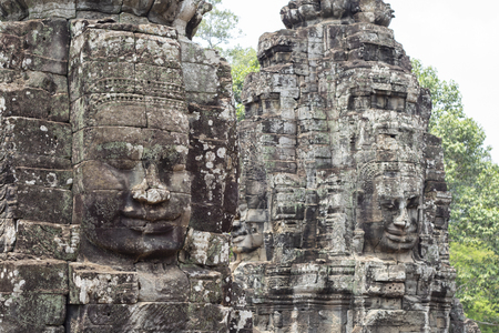 Stone face smile of ancient buddhist temple Bayon in Angkor Wat complex, Cambodia. Фото со стока