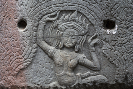 Ancient temple stone carved bas-relief in Angkor Wat.