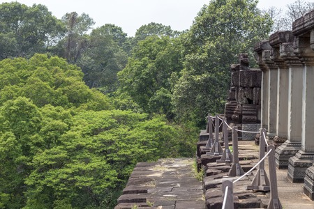 Ancient temple in Angkor Wat. Baphuon temple gallery view to forest. Buddhist or hindu temple landscape.
