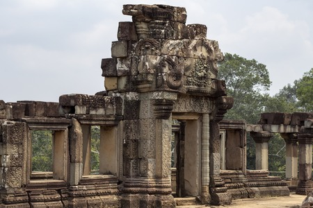 Ancient temple in Angkor Wat. Baphuon temple upper level gallery. Buddhist or hindu temple. Khmer architecture heritage. 스톡 콘텐츠
