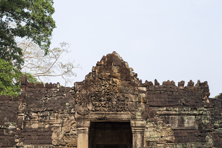 Ancient temple in Angkor Wat. Preah Khan temple entrance bas-relief stone carving. Buddhist or hindu temple. Khmer architecture heritage. Tourist place of interest in Cambodia. Asia travel sightseeing