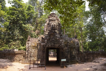 Ancient ruins of Ta Som temple in Angkor Wat complex, Cambodia. Tower with Buddha face on gate. Stone temple ruin. Abandoned temple in green jungle. Tourism and sightseeing place in Asia.