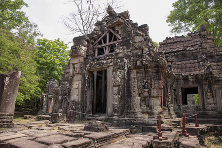 Ancient ruins of Banteay Kdei temple in Angkor Wat complex, Cambodia. Khmer heritage temple restoration with scaffoldings. Abandoned temple in green jungle. Tourism and sightseeing place in Asia.