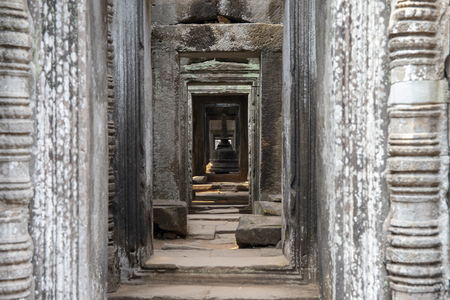 Ancient hindu temple interior decor, Angkor Wat, Cambodia. Preah Khan temple interior decor. Khmer heritage architecture detail - gallery with hindu stupa monument. Angkor Wat sightseeing photo.