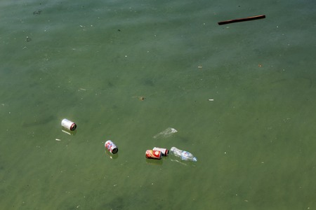 Bottles and cans in ocean. Trash on sea water surface. Ecological problem. Non-degradable seaside pollution. Human activity impact to wild life and natural environment. Oceanic pollution by tourism Stok Fotoğraf