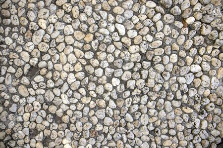 White pebble paving photo texture. Tiny marble gravel road. Pebble texture. Marine or seaside construction material. Stone mosaic natural backdrop. White pebble top view. Small stone flat surface