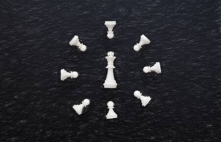 White chess clock on black background flat lay photo. White chess figures digital illustration. Chess on table flat lay. Chess clock top view. Checkmate game banner template. Intellectual sport