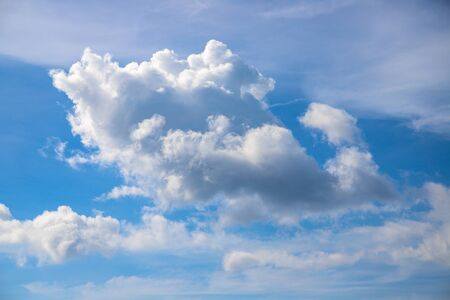 White cloud on blue sky. Sunny cloudscape photo background. Idyllic skyscape with fluffy cloud. Fluffy cloud on sunny sky. Climate or weather change. Zen or relax cover template. Cloudy sky overcast