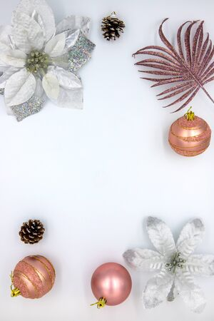 Christmas vertical flat lay with text space and fir tree decor. New Year decoration on white background. Winter holiday stories template. Pink and golden firtree bauble on table top view Zdjęcie Seryjne