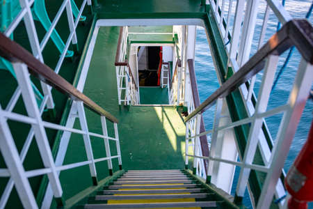 Ferry or cruise boat decks connected with stairs. Ferry deck upper and lower level. Budget travel option in South Asia. Tropical island hopping. Maritime vessel industrial interior. Sea travel concept