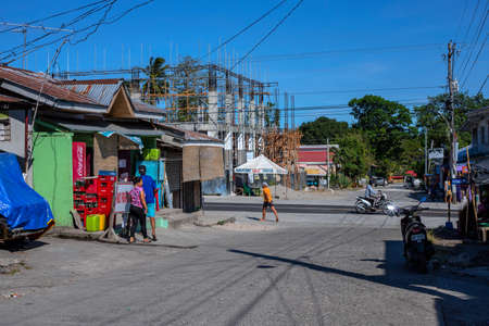 Dumaguete, the Philippines - 07 Apr 2020: empty street of philippine village during coronavirus quarantine. Modern filipino lifestyle. Stores and stall closed during pandemic community quarantine.