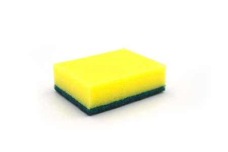 Yellow foam rubber sponge for dishwashing on white background. House cleaning tool. Simple everyday cleaning sponge studio photo. Everyday routine domestic chores. House duties equipment. Foam rubber