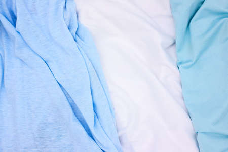 Blue and white fabric top view photo. Gentle colored textile photo texture. Folded fabric with wrinkles for pattern mockup. Blank textile surface. Fashion or retail industry banner template