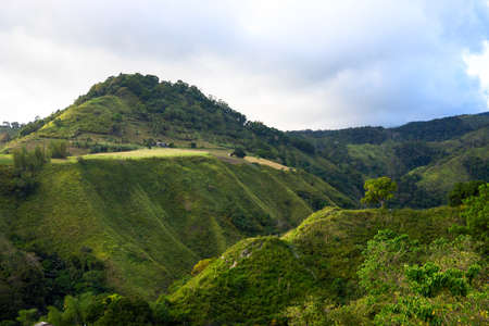 Tropical island landscape with green mountain and forest. Eco-tourism in South Asia. Hiking route view. Vietnam or Thailand mountain landscape. Green summer landscape of wild nature