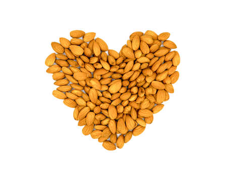Golden almond heart. Natural organic nut kernel. Protein superfood or healthy snack. Almond pile scattered on white table top view. Golden almond package design. Healthy eating banner template