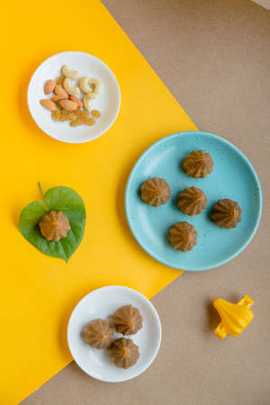 Modak is a tradtional Indian sweet dumpling offered to Elephant God Ganapati on Ganesh Chaturthi Festival. Made from rice flour and coconut jaggery filling.