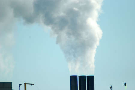 air pollution spews from an industrial smokestack