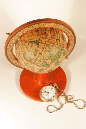 Old World Globe and a Pocket Watch Zdjęcie Seryjne
