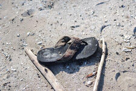Abandoned Flip Flop Sandal on the Beach